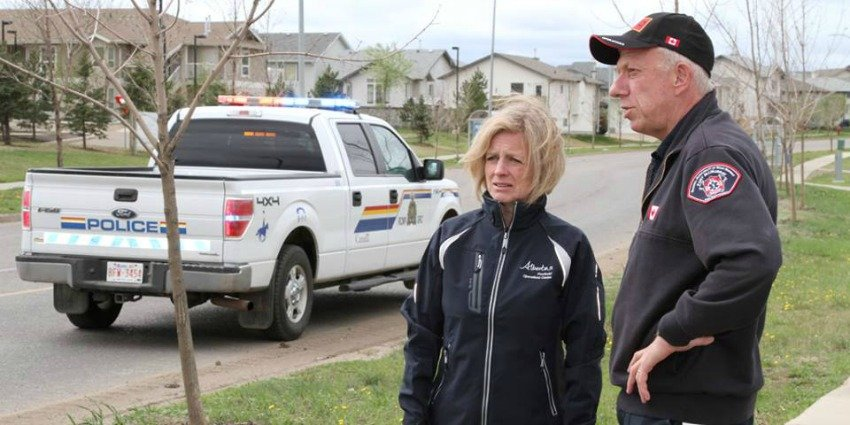 <who> Photo Credit: Royal Canadian Mounted Police in Alberta. </who> Alberta Premier, Rachel Notley, on an escorted tour of Fort McMurray.