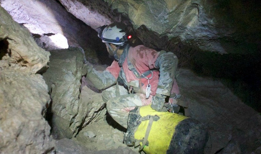 <who>Photo Credit: Jerome Genairon</who>Hauling packs is one of the most physically challenging aspects of caving.