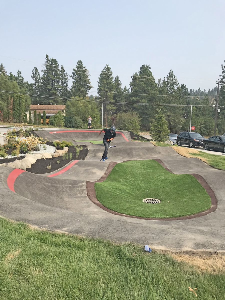 <who>Photo Credit: Jacquie Biblow</who>Councillor Tom Konek going for a whirl on the state-of-the-art Pump Track