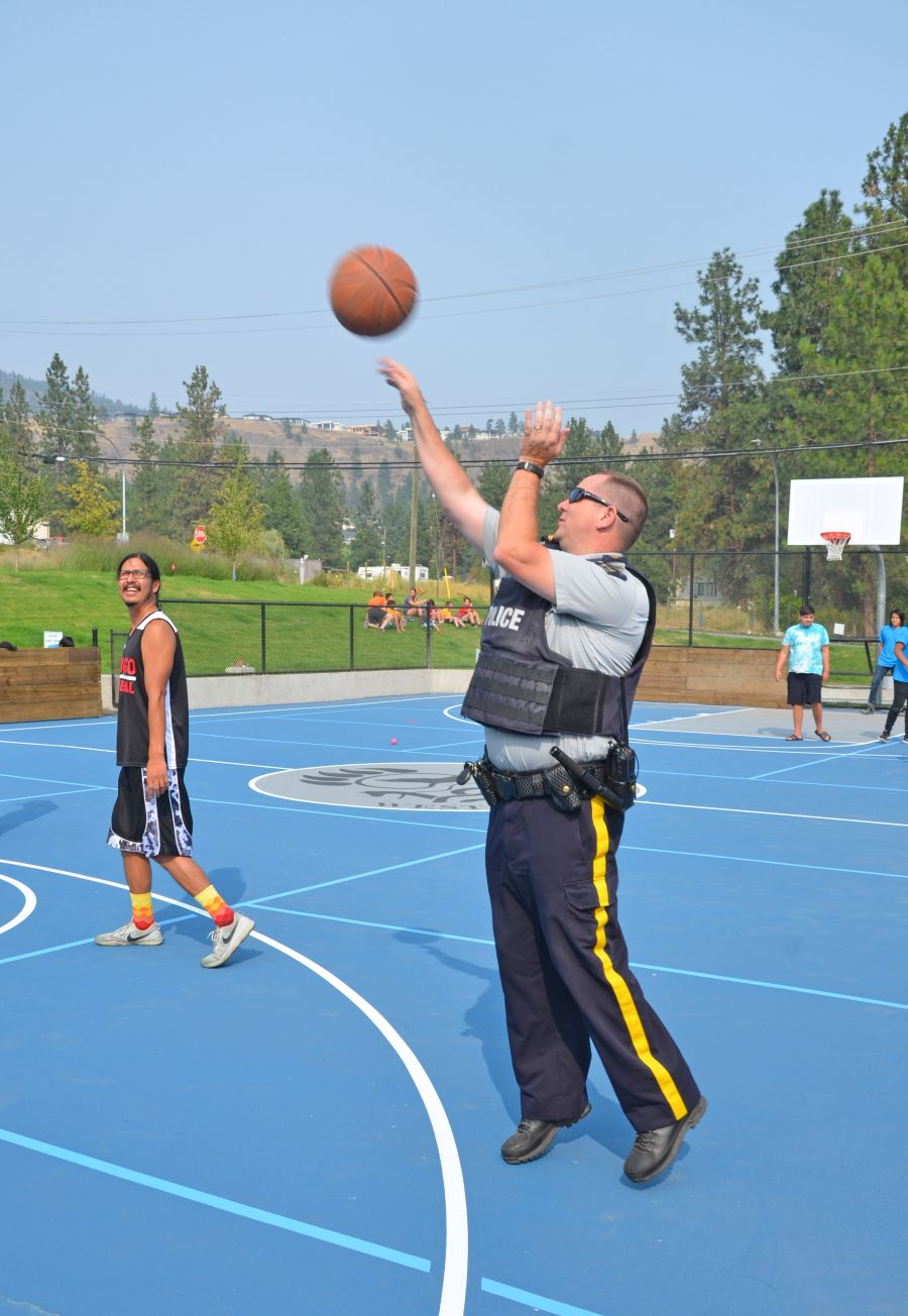 <who>Photo Credit: Jacquie Biblow</who>Corporal Mike Williams throwing up three-pointers with Will Swite in the new Sport Court