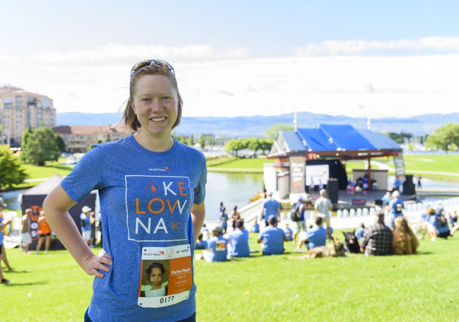 <who> Lauren May poses for a portrait before the World Vision Global 6K for Water event at Tugboat Bay in Downtown Kelowna on Sat. July 7, 2018. May has sponsored a child since 2012 through World Vision. Photo Credit:NowMedia.</who>