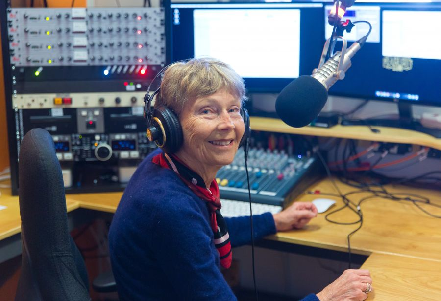 <who> Photo Credit: NowMedia</who>Programming trainee Carole Punt in the station's studio.