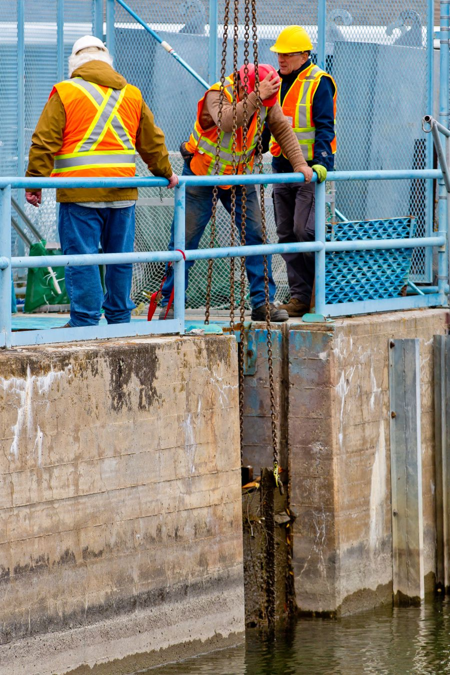 <who>Photo Credit: NowMedia</who> A second board is removed from the top gate of the fish ladder