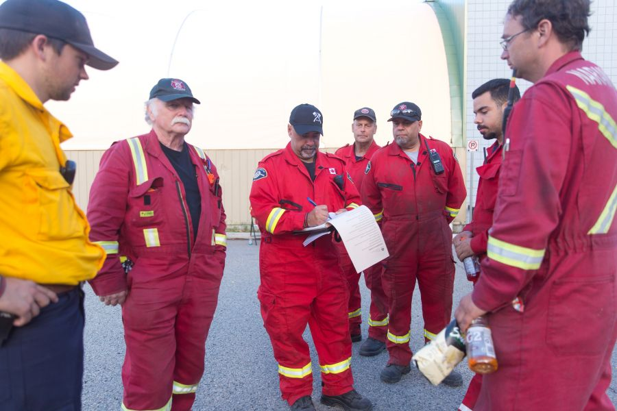 <who>Photo Credit: NowMedia</who> The squad from the Naramata Fire Department pour over their notes