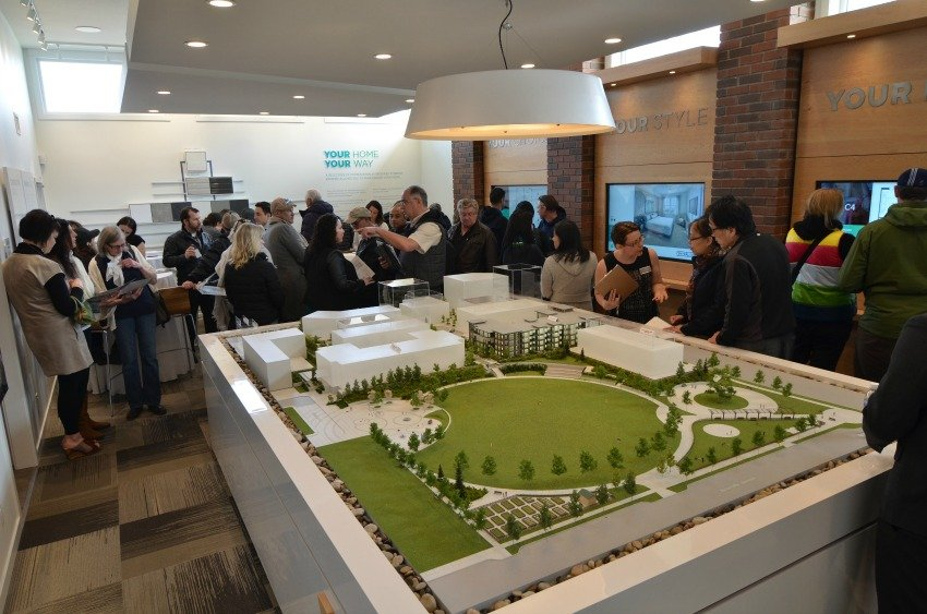 <who> Photo Credit: Mission Group </who> The open houses at Central Green was filled with people each day.
