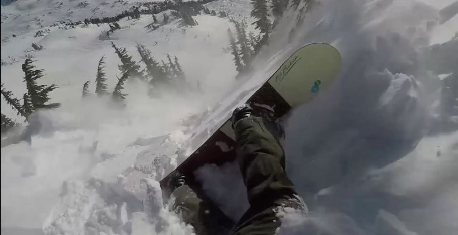 Scary video shows a snowboarder almost getting swallowed up by an avalanche