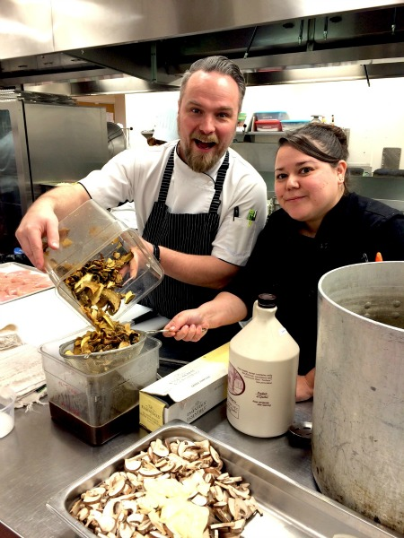 <who> Photo Courtesy: Okanagan College. </who> Chantelle Eustache with Chef Ryan O'Flynn as they are getting ready to prepare a VIP culinary feast for the 2016 Gold Medal Plates.