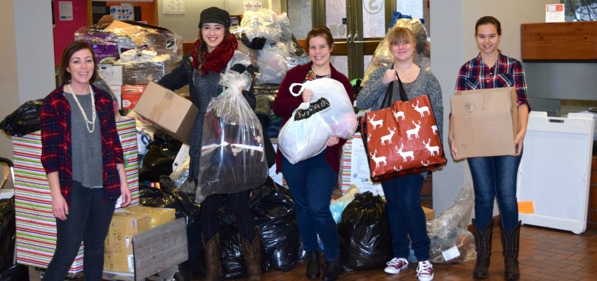 <who> Photo Credit: Contributed. </who> Okanagan College Nursing students collected six truck loads of donated warm clothing.