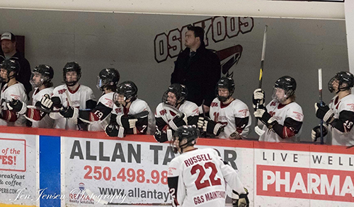 <who> Photo Credit: Jen Jensen </who> Carter Rigby behind the Coyotes bench.