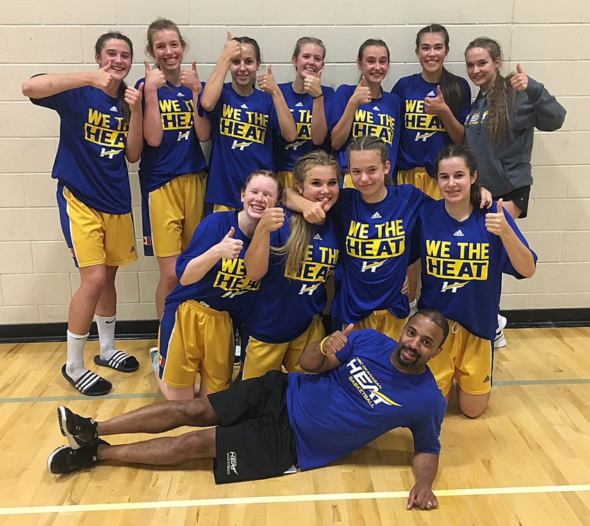 <who>Photo Credit: Contributed</who>The UBCO U17 Junior Heat team finished the season with an overall record of 28-7. Members of the team, coached by Bobby Mitchell (front), are from left, middle: Jenna Robinson, Kassidy Day, Lexi Corday and Melania Corrado. Back: Kelsey Falk, Jordan Kemper, Paige Watson, Naomi Kent, Katrina Fink, Jaeli Ibbetson, and Rylee Semeniuk.