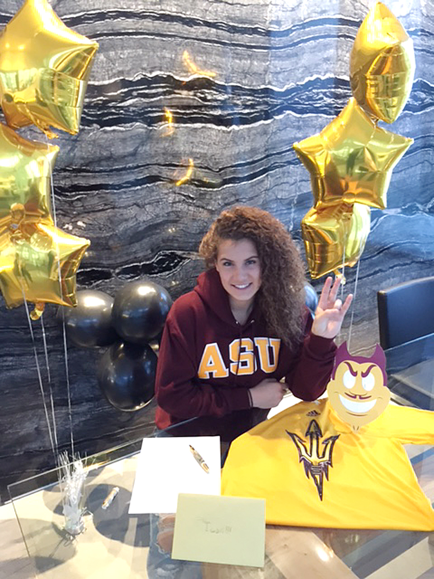 <who>Photo Credit: Contributed </who>Taya Hanson is all smiles at the official signing with Arizona State University and the W. P. Carey Business School.