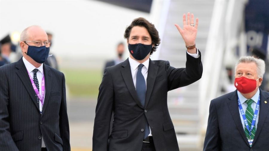 </who>Liberal Prime Minister Justin Trudeau did, and sometimes didn't, wear a mask while at the G7 Summit in England from June 11-13.