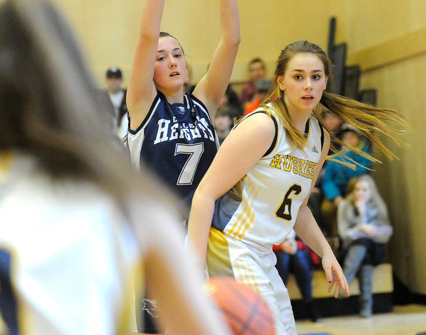 <who>Photo Credit: Lorne White/KelownaNow </who>Jordan Robb scored 25 points and pulled down 29 rebounds in four games for the Huskies.