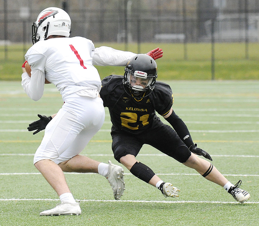 <who>Photo Credit: Lorne White/KelownaNow </who>Kieran Koltun of the Owls defends on the Eagles' James Curleigh. Koltun scored a pair of touchdowns for the Owls.