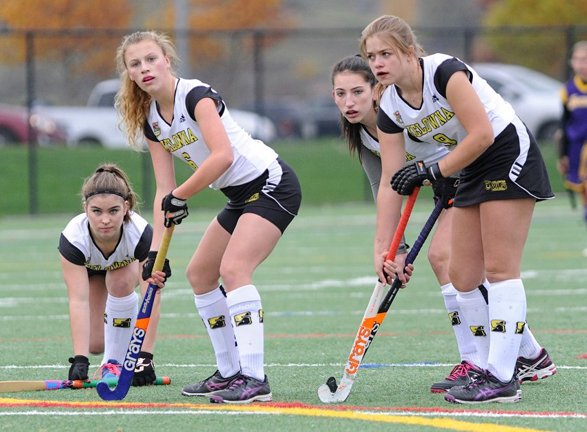 <who>Photo Credit: Lorne White/KelownaNow </who>From left, Grace Fecht, Holly McGarvey, Grace DeMug and Hannah Phlen of the Kelowna Owls set up for a short corner in the senior AAA field hockey final at CNC's Mission Stadium.