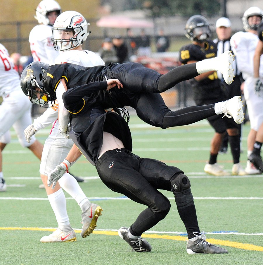 <who>Photo Credit: Lorne White/KelownaNow </who>Isaac Athans, top, and Nathan Gilbert collide while trying to pick off a Carson Graham pass in the second quarter.