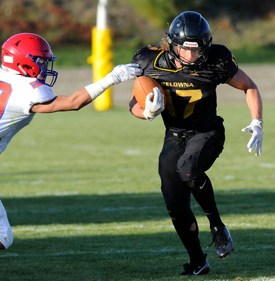 <who>Photo Credit: Lorne White/KelownaNow </who>The Owls' Nolan Ulm caught two touchdown passes and accumulated 88 yards against Terry Fox.