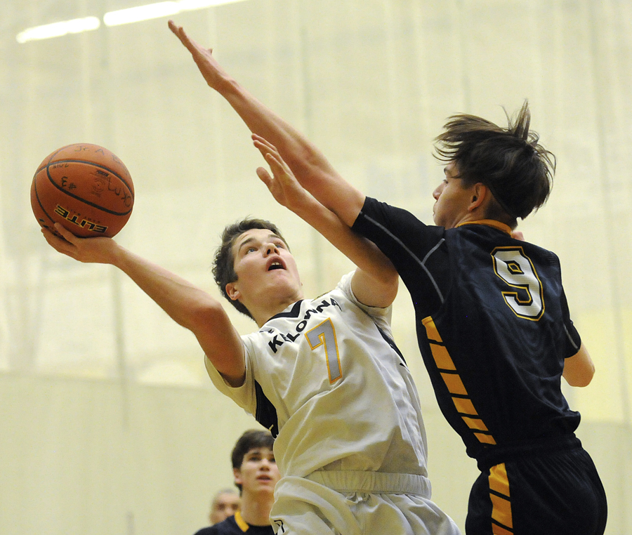 <who>Photo Credit: Lorne White/KelownaNow </who>Valley all-star, Nate Beauchemin, of the Owls in tough against the Huskies' Kaden Kiewitz.