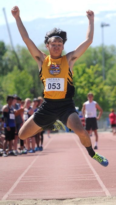 <who>Photo Credit: Lorne White/KelownaNow </who>Nathan Tonogai of KSS leaps to Valley's long jump title.