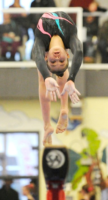 <who>Photo Credit: Lorne White/KelownaNow </who>Lucia Jakab performs on the beam in the HP Junior category.