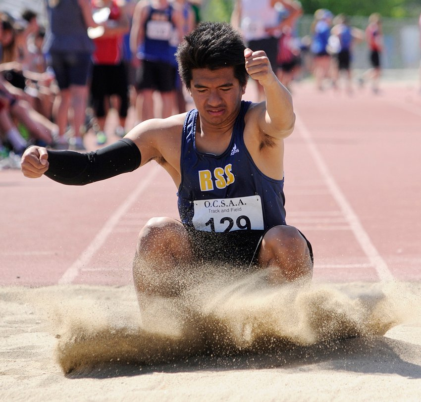 <who>Photo Credit: Lorne White/KelownaNow </who>Rutland Secondary's Dwight Cuadra placed fifth in the senior boys long jump.