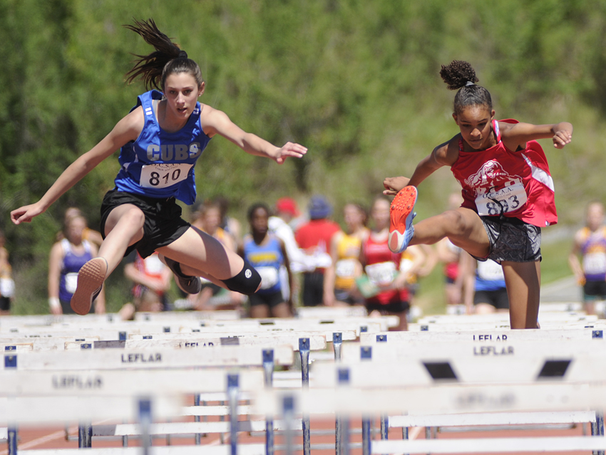 <who>Photo Credit: Lorne White/KelownaNow </who>Elayna Glen, left, of the CNB Cubs claimed two firsts and a second while Mekhila Brown of KLO ran to a first and jumped to a pair of seconds.