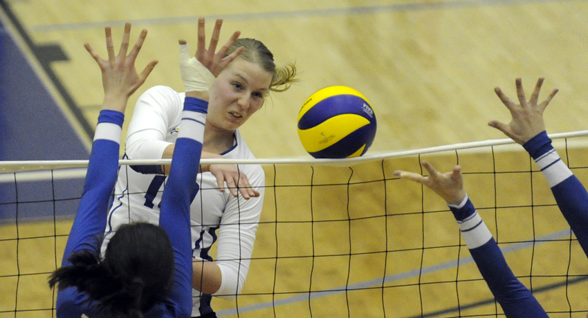 <who>Photo Credit: Lorne White/KelownaNow.com </who>Middle Katy Klomps powers the ball off the net for one of her six kills in the Final Four semifinal.