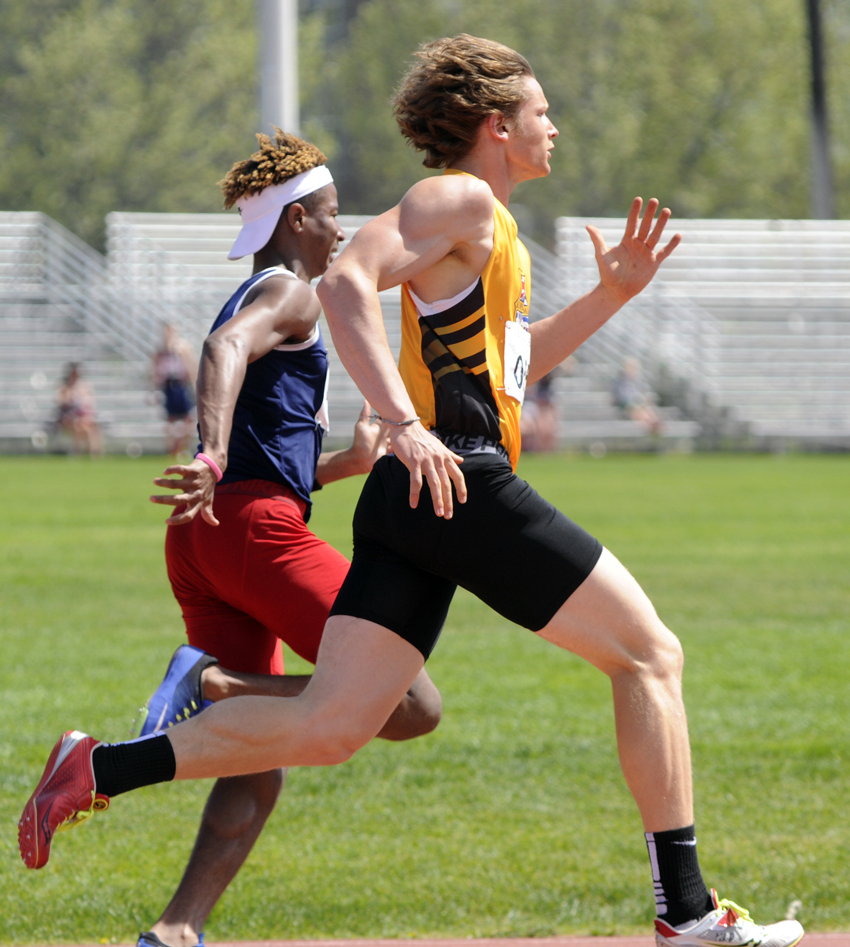 <who>Photo Credit: Lorne White/KelownaNow </who>Nolan Ulm of the KSS Owls, right, ran to three firsts and a record junior relay win.