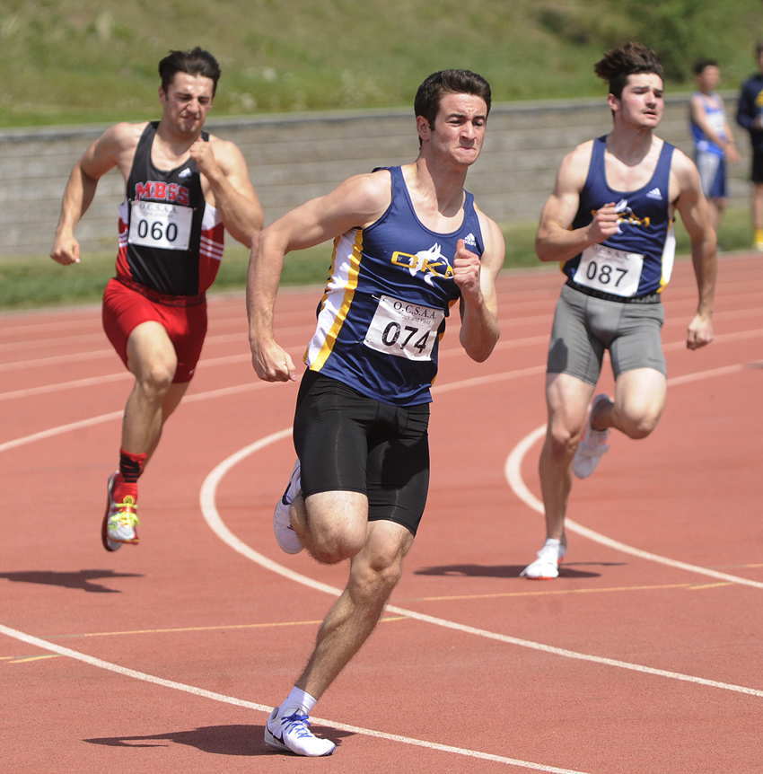 <who>Photo Credit: Lorne White/KelownaNow </who>Alex Gross, centre, of the OKM Huskies raced to first in both the senior 100- and 200-metre sprints.