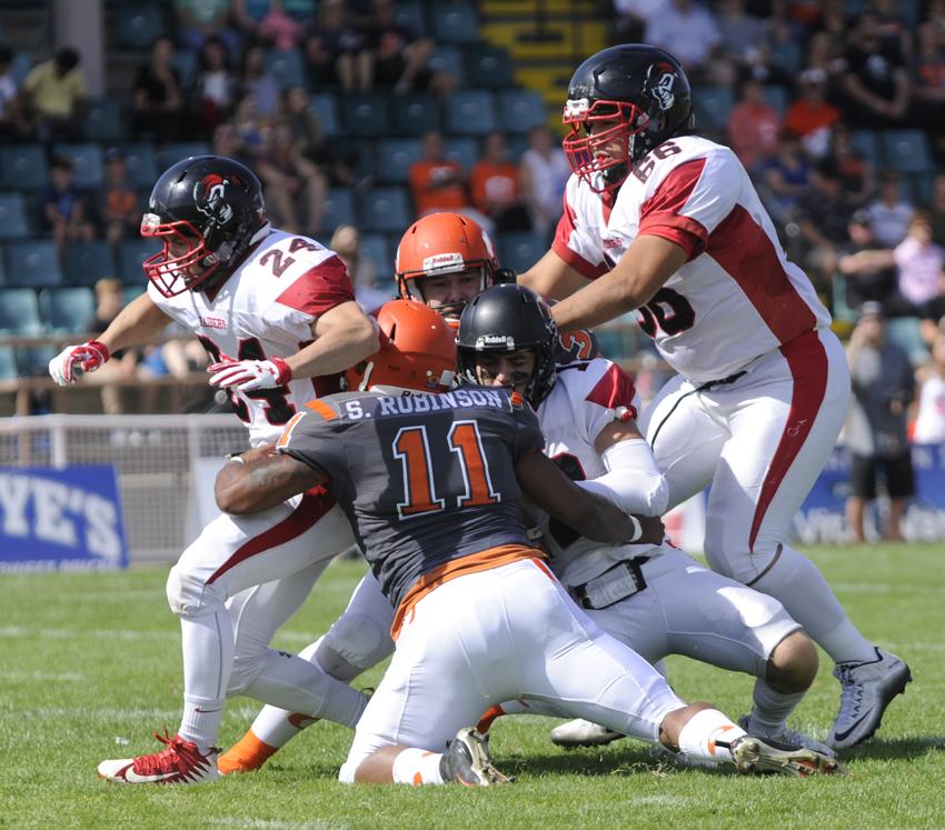 <who>Photo Credit: Lorne White/KelownaNow </who>Shaun Robinson (11) of the Sun broke through for two quarterback sacks on the day.