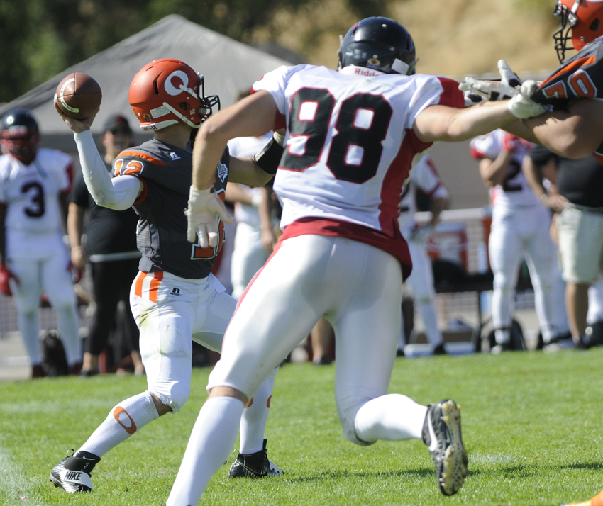 <who>Photo Credit: Lorne White/KelownaNow </who>Under pressure, Sun QB Nick Wenman winds up for a touchdown pass to Sharmar Donalson in the second quarter on Sunday.