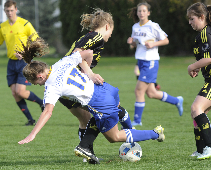 <who>Photo Credit: Lorne White/KelownaNow </who>The Rutland Voodoos' Josie Stutters (foreground) gets tangled up with Natalie Hope of the Kelowna Owls in the second half of their Okanagan Valley league game on Monday at Rutland Sportsfields.
