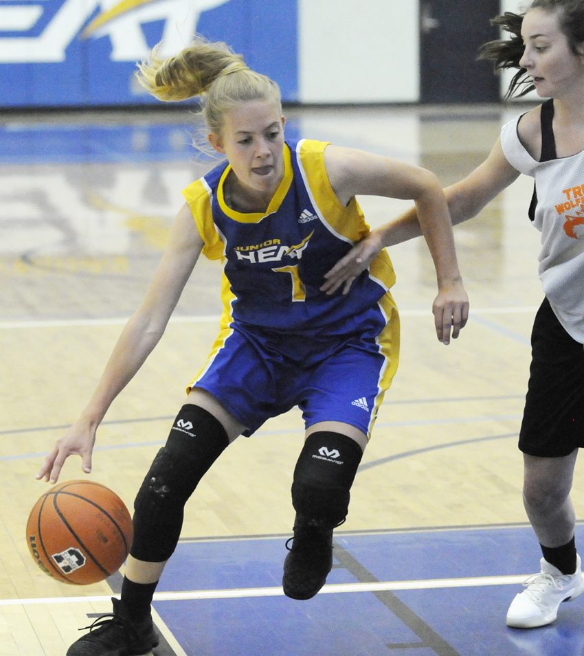 <who>Photo Credit: Lorne White/KelownaNow </who>Kelowna Christian School product Naomi Kent scored 22 points in a convincing Heat win over Lethbridge