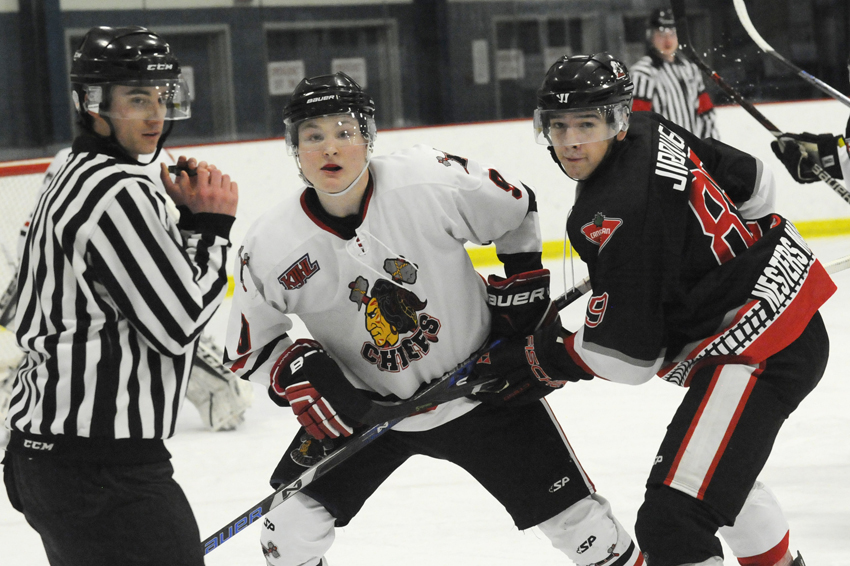 <who>Photo Credit: Lorne White/NowMedia </who>Brody Dale, centre, scored once and assisted on five other goals in the Chiefs' 11-4 win over Steam.
