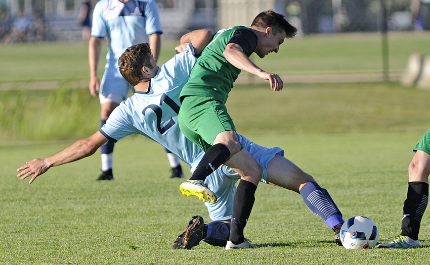 <who>Photo Credit: Lorne White/KelownaNow </who>Andrew Stevenson, left, of the Okanagan FC reaches to make contact with the ball ahead of DekSmart's Shea Ottey.