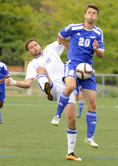 <who>Photo Credit: Lorne White/KelownaNow </who>Tyler Shalansky of the Heat cradles the ball on a goal kick in <br>front of a UBC T-Bird defender.