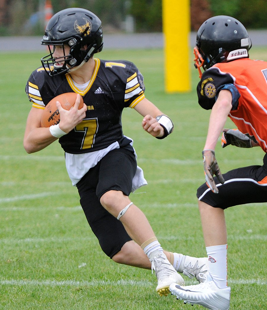 <who>Photo Credit: Lorne White/KelownaNow </who>Quarterback Nate Beauchemin orchestrated a potent KSS offence and came through with key plays on defence to lead his team to a surprisingly lopsided win over Lord Tweedsmuir.
