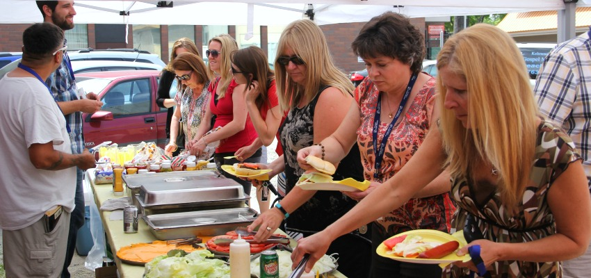<who> Photo Credit: KelownaNow. </who> Members of various agencies gathered at Kelowna's Gospel Mission on Wednesday to enjoy a special barbecue.