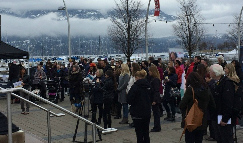 <who> Photo Credit: KelownaNow </who> Despite the cold, a large crowd gathered at Stuart Park in Kelowna to celebrate International Women's Day on March 8, 2018.
