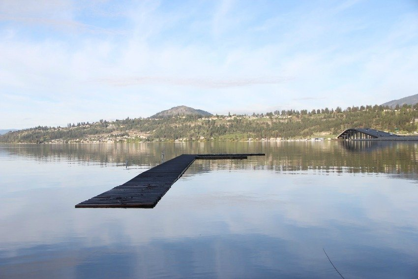 <who> Photo Credit: KelownaNow </who> Half sunken dock by Mushroom Beach.