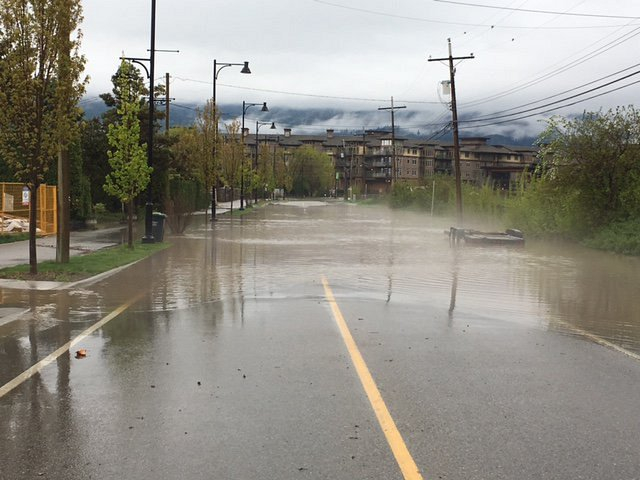 <who> Photo Credit: District of West Kelowna. </who> Flooding on Gellatly Road.