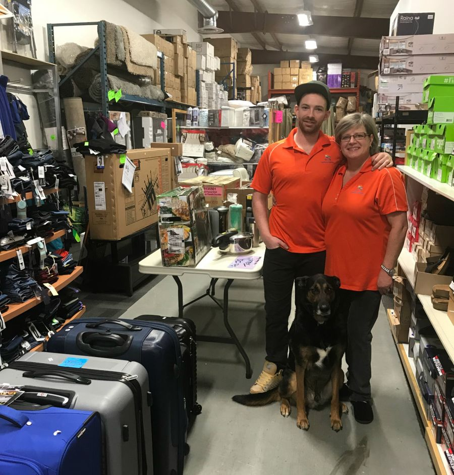 <who>Photo Credit: Contributed</who>Nicholas Schaffland, Lu-Anne Tew and Atticus the dog - Owners of Sun City Liquidations and Auctions