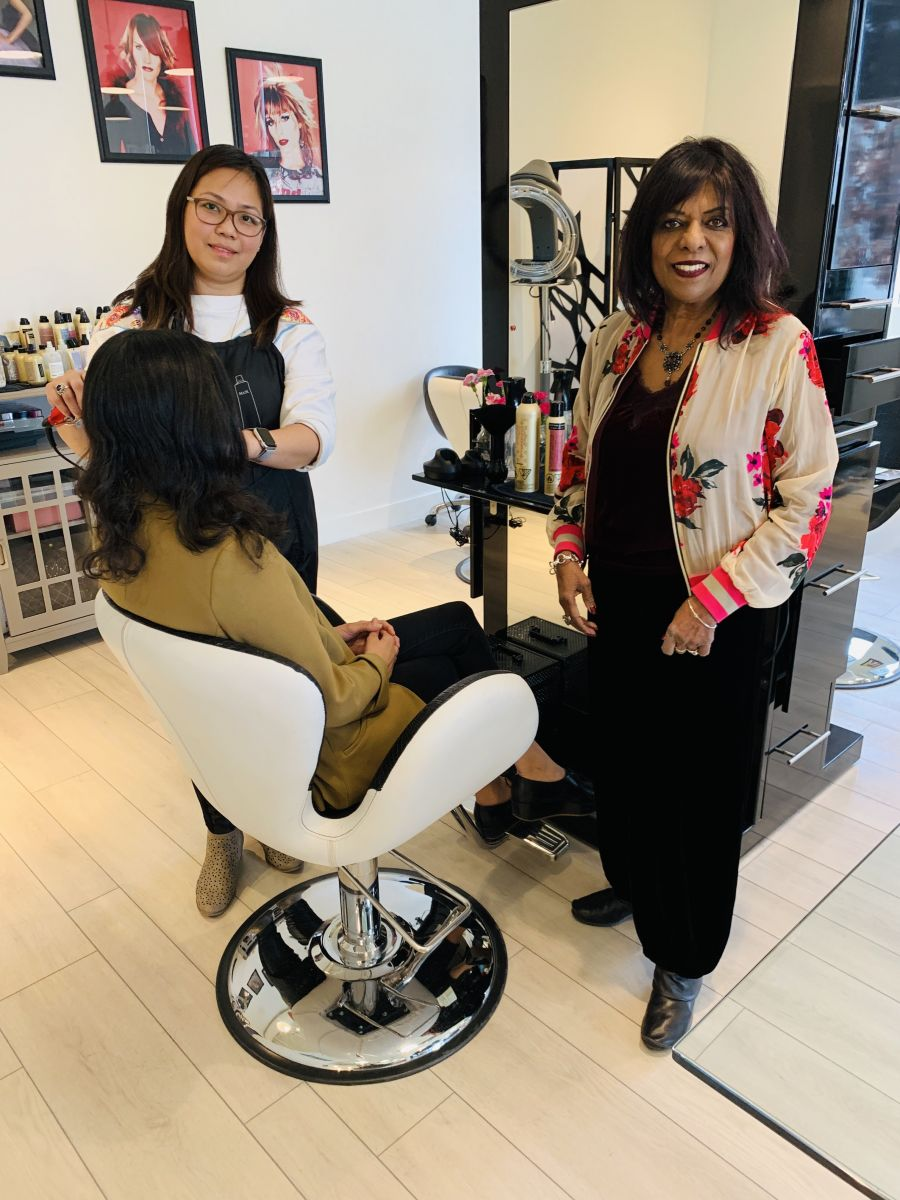 <who>Photo Credit: Contributed</who>Rosalind Satar (R), owner of Gini's Salon International