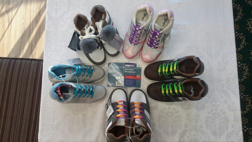 <who>Photo Credit: Contributed</who>11,000 pairs of Sneakers from Vienna Austria - sale at Ramada Hotel.