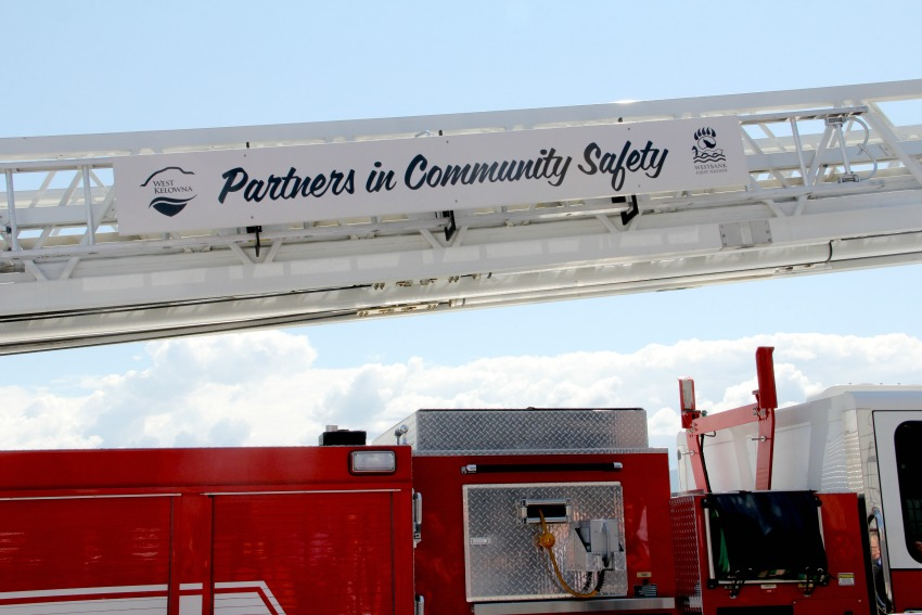 <who> Photo Credit: KelownaNow. </who> A fire truck, new to the service, has been painted to represent the partnership.