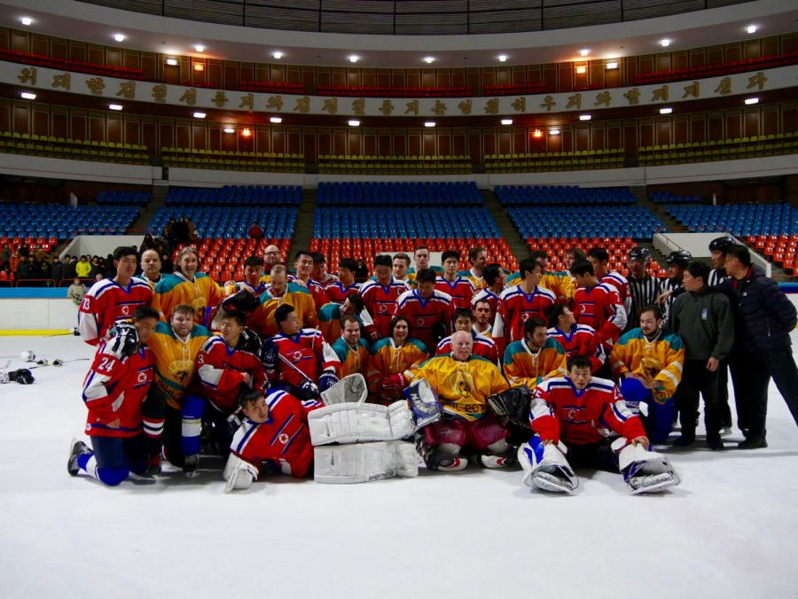 <who> Contributed by Morgan Parker </who> The North Korean team in red and the HIFL team in yellow