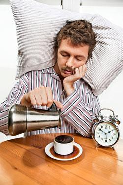 sleepy-guy-with-coffee.jpg
