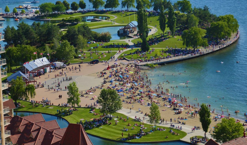 <who>Photo Credit: KelownaNow</who>You won't be seeing Kelowna's beaches this packed for quite some time.