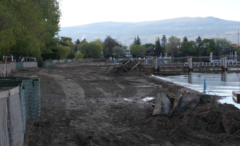<who> Photo Credit: KelownaNow </who> Shorelines of Okanagan Lake have risen significantly over the past month.