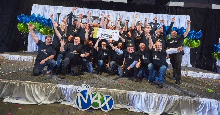 Thirty one instant millionaires: NL construction co-workers presented with $60M cheque